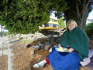 Randi Hansen tries to save a Ballard tree. The tree was later cut while she slept.